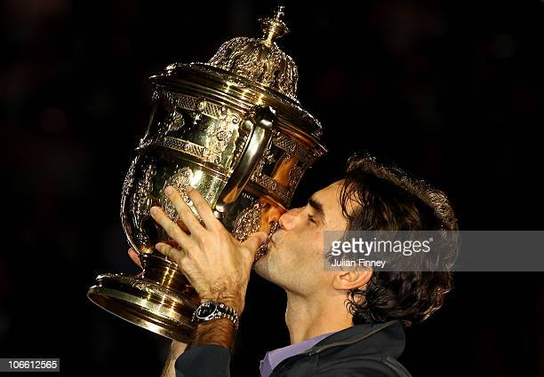 Roger Federer of Switzerland kisses the trophy after defeating Novak Djokovic of Serbia in the final during Day Seven of the Davidoff Swiss Indoors...