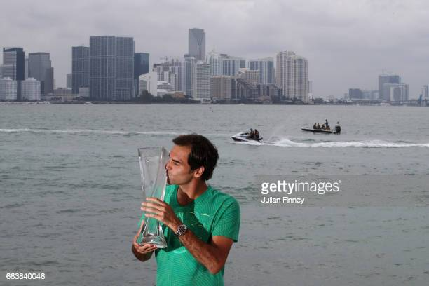 Roger Federer of Switzerland kisses the trophy in front of the Miami skyline after defeating Rafael Nadal of Spain in the final at The Rusty Pelican...