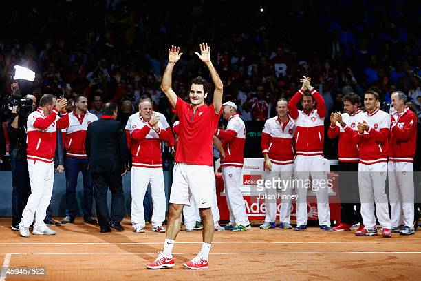 Roger Federer of Switzerland leads the celebrations after defeating Richard Gasquet of France as Stanislas Wawrinka of Switzerland Marco Chiudinelli...
