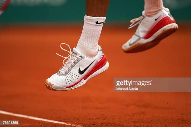 Roger Federer of Switzerland leaps after serving during his match against Hyung-Taik Lee of South Korea on Day Four of the Masters Series at the...