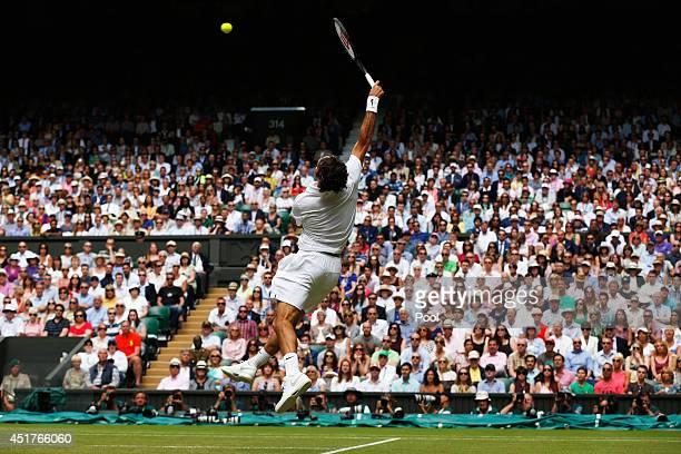 Roger Federer of Switzerland leaps to make a return during the Gentlemen's Singles Final match against Novak Djokovic of Serbia on day thirteen of...