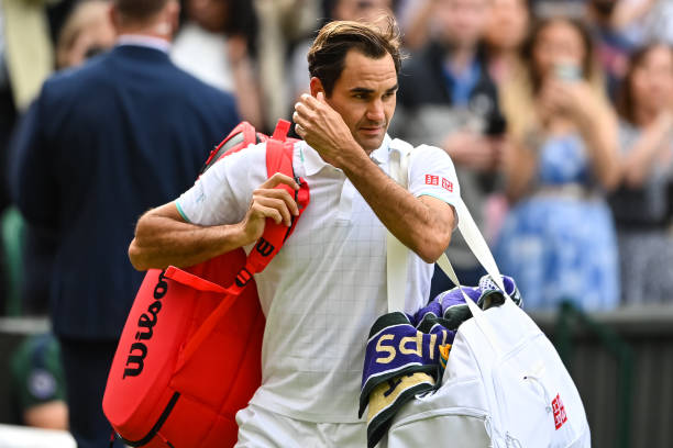 Roger Federer of Switzerland leaves centre court after his loss to Hubert Hurkacz of Poland in the quarter finals of the gentlemen's singles during...