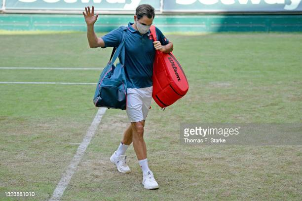 Roger Federer of Switzerland leaves the Center Court after losing his match against Felix Auger-Aliassime of Canada during day 5 of the Noventi Open...