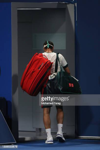 Roger Federer of Switzerland leaves the court after defeat to Nikoloz Basilashvili of Georgia in their quarter final match during the Qatar...