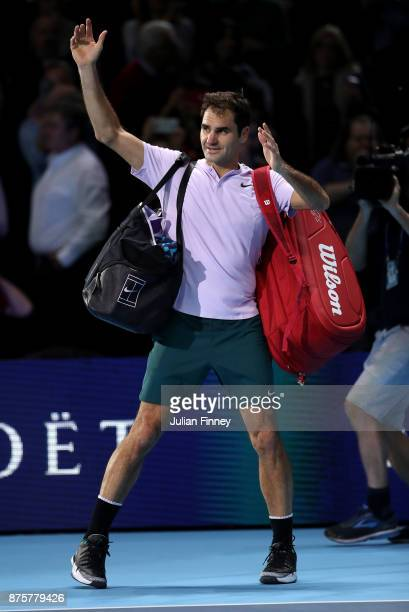 Roger Federer of Switzerland leaves the court after hs loss to David Goffin of Belgium in the semi finals during day seven of the Nitto ATP World...