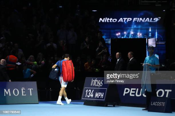 Roger Federer of Switzerland leaves the court after loosing his semi finals singles match to Alexander Zverev of Germany during Day Seven of the...