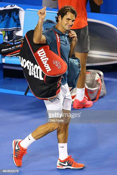 Roger Federer of Switzerland leaves the court after losing his semifinal match against Rafael Nadal of Spain during day 12 of the 2014 Australian...