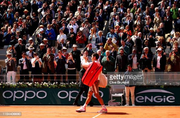 Roger Federer of Switzerland leaves the court following defeat during his mens singles semi-final match against Rafael Nadal of Spain during Day...