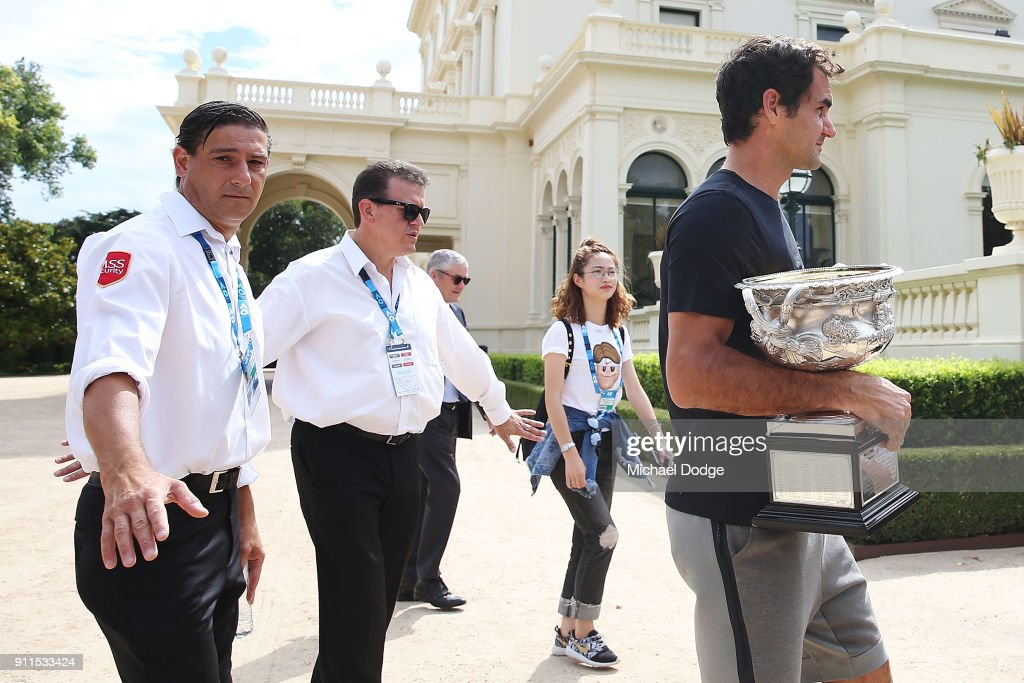 Roger Federer of Switzerland leaves with the Norman Brookes Challenge Cup after winning the 2018 Australian Open Men's Singles Final, at Government House on January 29, 2018 in Melbourne, Australia.