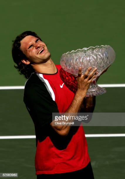 Roger Federer of Switzerland lifts the trophy after defeating Rafael Nadal of Spain in the men's final during the NASDAQ100 Open at the Crandon Park...