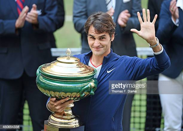 Roger Federer of Switzerland lifts the trophy after winning the final match against Alejandro Falla of Colombia of the Gerry Weber Open at Gerry...