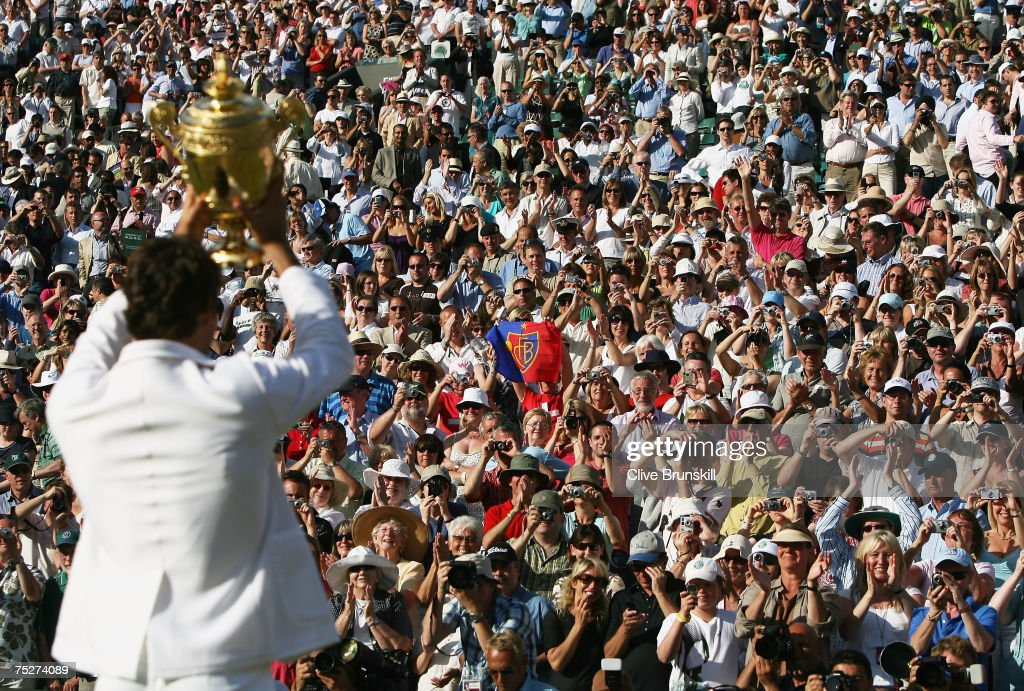 Roger Federer of Switzerland lifts the trophy as he celebrates victory following the Men's Singles final match against Rafael Nadal of Spain during day thirteen of the Wimbledon Lawn Tennis Championships at the All England Lawn Tennis and Croquet Club on July 8, 2007 in London, England. Roger Federer claims his fifth consecutive championship title.