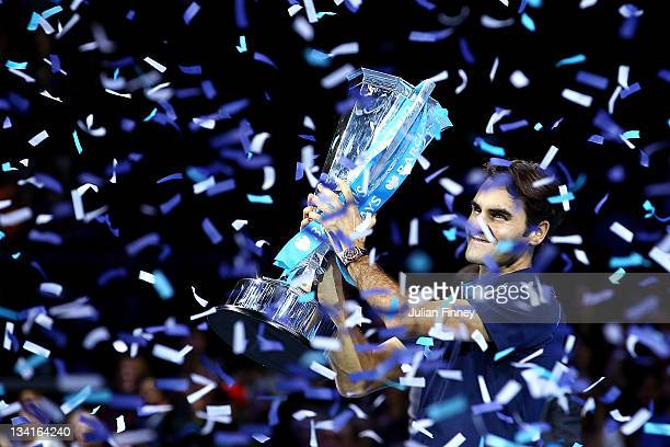 Roger Federer of Switzerland lifts the trophy following his victory during the men's final singles match against Jo-Wilfried Tsonga of France during...