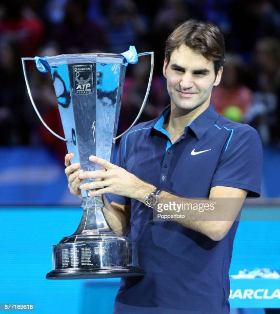 Roger Federer of Switzerland lifts the trophy following his victory during the men's final singles match against JoWilfried Tsonga of France during...