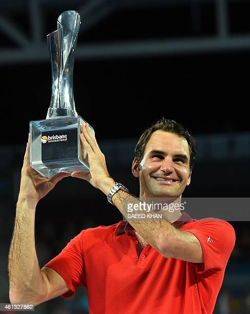 Roger Federer of Switzerland lifts the winner's trophy after he defeated Milos Raonic of Canada in the men's single final of the Brisbane...