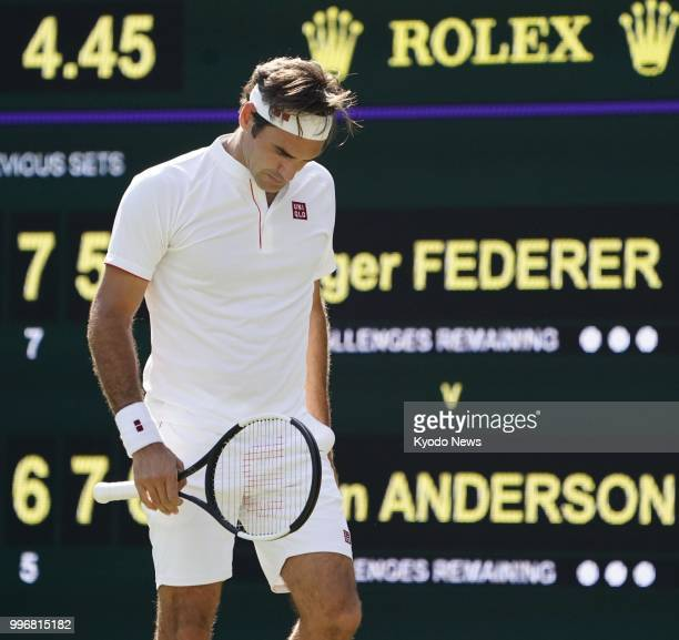 Roger Federer of Switzerland looks dejected after missing a point during a quarterfinal match against Kevin Anderson of South Africa at Wimbledon in...