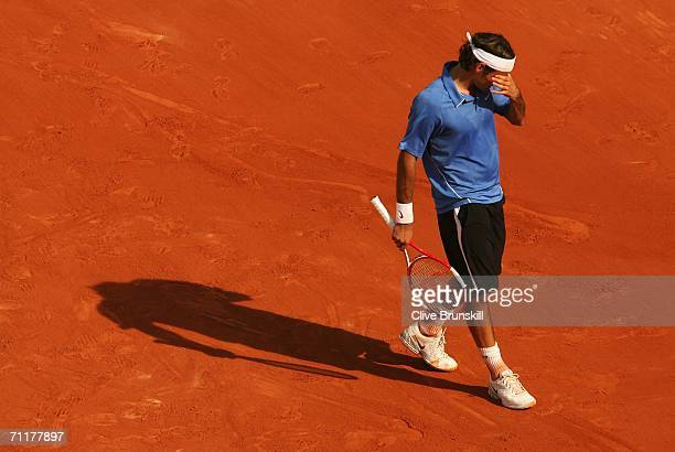 Roger Federer of Switzerland looks dejected against Rafael Nadal of Spain during the Mens Singles Final on day fifteen of the French Open at Roland...