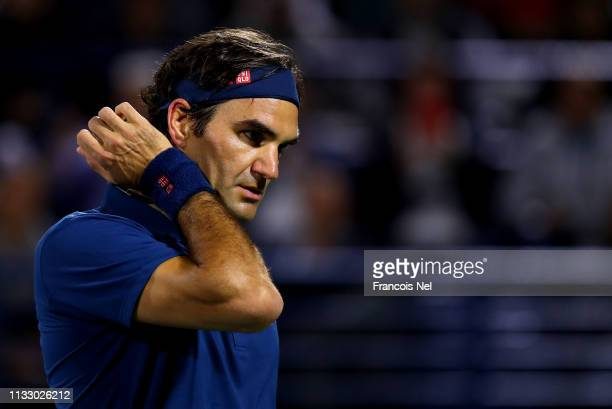 Roger Federer of Switzerland looks on against Borna Coric of Croatia during in his men's semi final match on day thirteen of the Dubai Duty Free...
