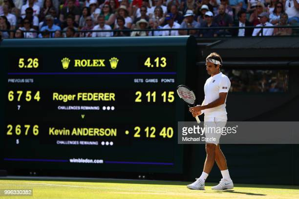 Roger Federer of Switzerland looks on against Kevin Anderson of South Africa during their Men's Singles QuarterFinals match on day nine of the...