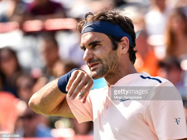 Roger Federer of Switzerland looks on against Robin Haase of Netherlands during day nine of the Rogers Cup presented by National Bank at Uniprix...