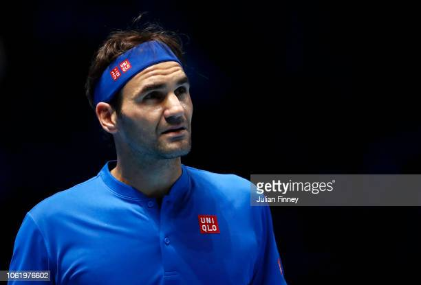 Roger Federer of Switzerland looks on during his round robin match against Kevin Anderson of South Africa during Day Five of the Nitto ATP Finals at...