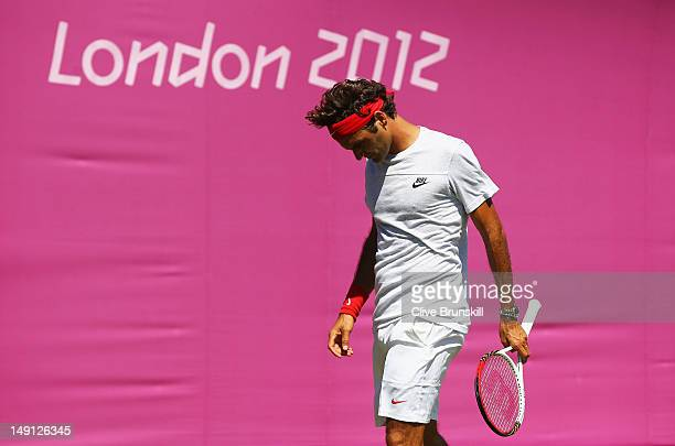 Roger Federer of Switzerland looks on in a practice session during previews ahead of the 2012 London Olympic Games at the All England Lawn Tennis and...