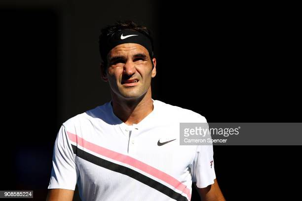 Roger Federer of Switzerland looks on in his fourth round match against Marton Fucsovics of Hungary on day eight of the 2018 Australian Open at...