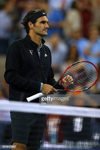 Roger Federer of Switzerland looks on prior to playing Gael Monfils of France in their men's singles quarterfinal match on Day Eleven of the 2014 US...