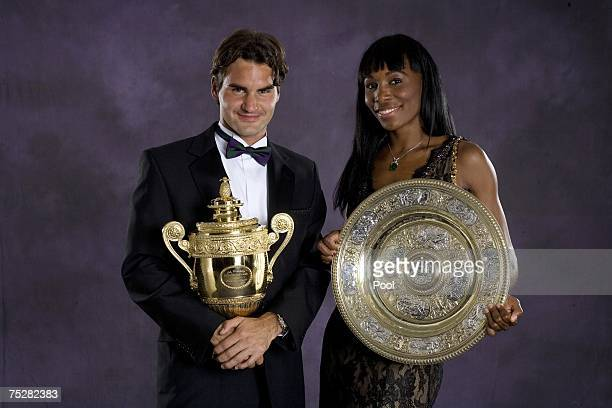 Roger Federer of Switzerland, men's singles Wimbledon champion, and Venus Williams, women's Wimbledon champion, pose together at the Champions'...