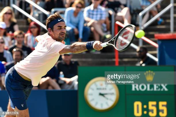 Roger Federer of Switzerland misses the ball against Robin Haase of Netherlands during day nine of the Rogers Cup presented by National Bank at...