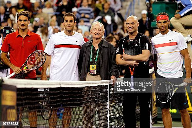 Roger Federer of Switzerland Pete Sampras former tennis player Rod Laver Andre Agassi and Rafael Nadal of Spain pose at Hit for Haiti a charity event...