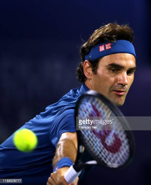 Roger Federer of Switzerland plays a backhand against Borna Coric of Croatia during his men's semi final match on day thirteen of the Dubai Duty Free...