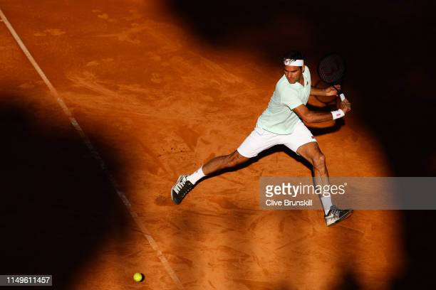 Roger Federer of Switzerland plays a backhand against Borna Coric of Croatia in their Men's Singles Round of 16 match during Day Five of the...