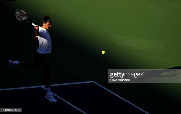 Roger Federer of Switzerland plays a backhand against Dominic Thiem of Austria during their men's singles final on day fourteen of the BNP Paribas...