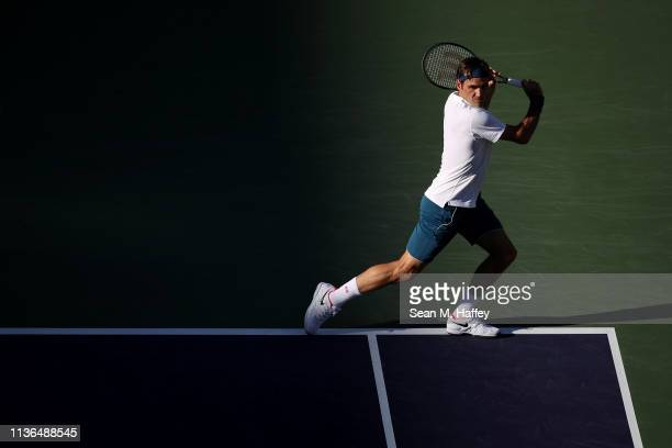 Roger Federer of Switzerland plays a backhand against Dominic Thiem of Austria during their men's singles final match at the BNP Paribas Open at the...