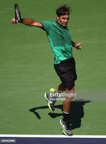 Roger Federer of Switzerland plays a backhand against Jack Sock of the United States in their semi final match during day thirteen of the BNP Paribas...