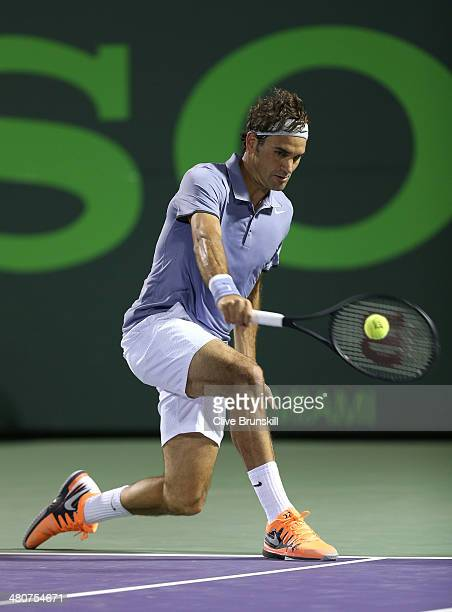 Roger Federer of Switzerland plays a backhand against Kei Nishikori of Japan during their quarter final round match during day 10 at the Sony Open at...