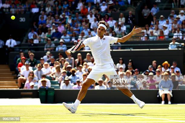 Roger Federer of Switzerland plays a backhand against Kevin Anderson of South Africa during their Men's Singles QuarterFinals match on day nine of...