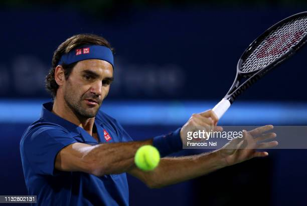 Roger Federer of Switzerland plays a backhand against Marton Fucsovics of Hungary during day twelve of the ATP Dubai Duty Free Tennis Championships...