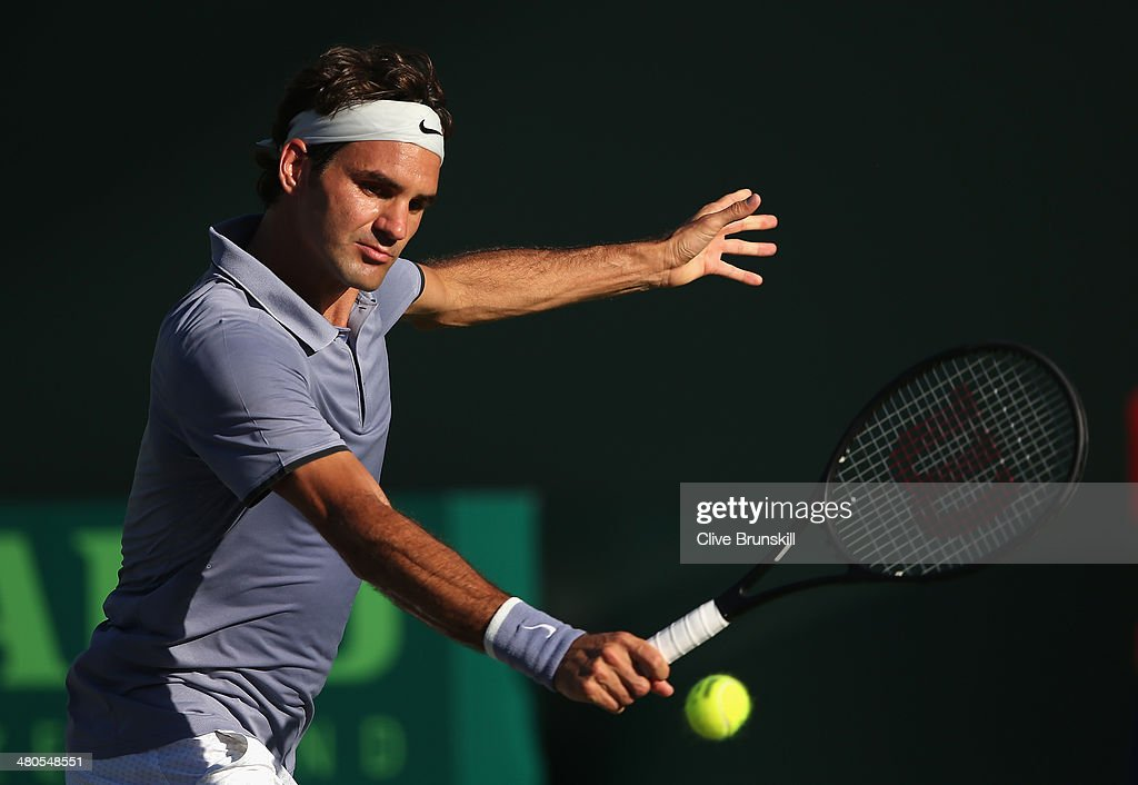 Roger Federer of Switzerland plays a backhand against Richard Gasquet of France during their fourth round match during day 9 at the Sony Open at Crandon Park Tennis Center on March 25, 2014 in Key Biscayne, Florida.