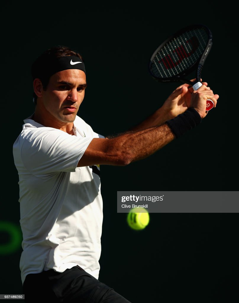 Roger Federer of Switzerland plays a backhand against Thanasi Kokkinakis of Australia in their second round match during the Miami Open Presented by Itau at Crandon Park Tennis Center on March 24, 2018 in Key Biscayne, Florida.