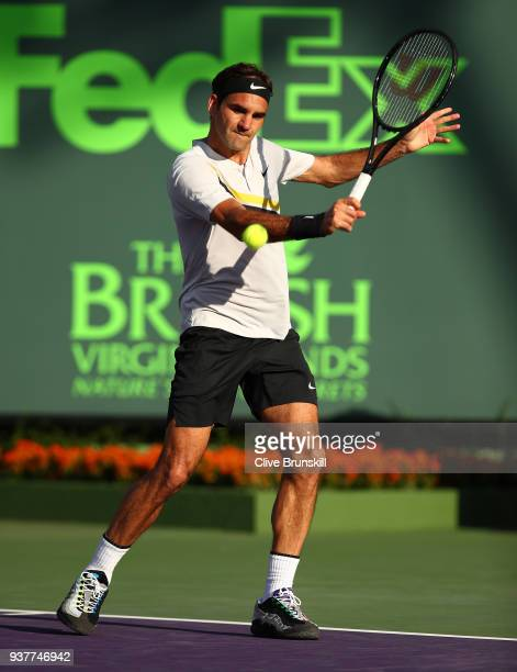 Roger Federer of Switzerland plays a backhand against Thanasi Kokkinakis of Australia in their second round match during the Miami Open Presented by...