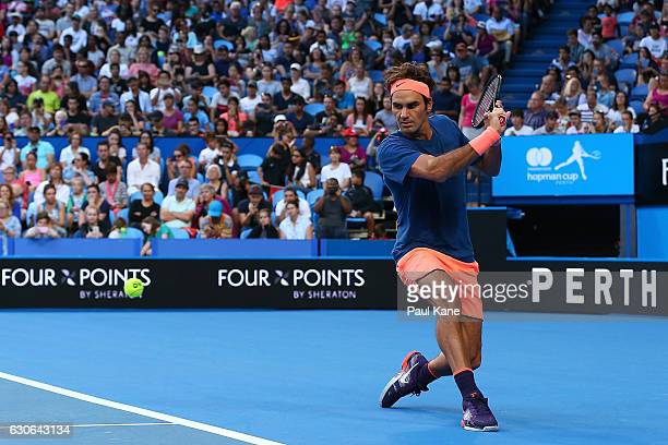 Roger Federer of Switzerland plays a backhand during a practice session at the Perth Arena on December 29 2016 in Perth Australia