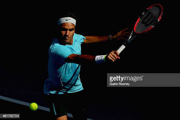 Roger Federer of Switzerland plays a backhand during a practice session ahead of the 2015 Australian Open at Melbourne Park on January 18 2015 in...