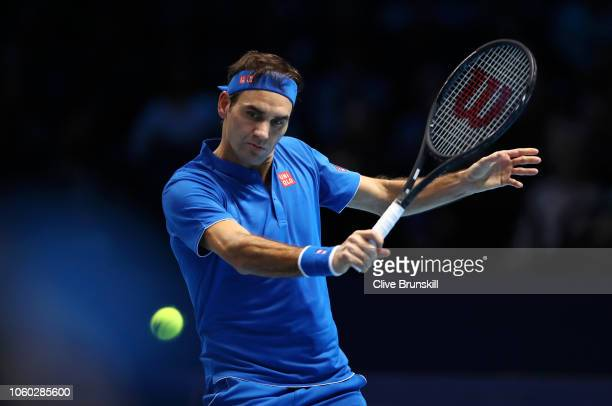 Roger Federer of Switzerland plays a backhand during his match against Kei Nishikori of Japan during Day One of the Nitto ATP Finals at The O2 Arena...