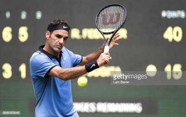 Roger Federer of Switzerland plays a backhand during his match against Yuichi Sugita of Japan during Day 4 of the Gerry Weber Open 2017 at on June 20...
