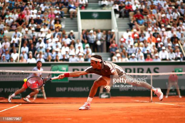 Roger Federer of Switzerland plays a backhand during his mens singles quarterfinal match against Stan Wawrinka of Switzerland during Day ten of the...