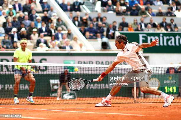 Roger Federer of Switzerland plays a backhand during his mens singles semi-final match against Rafael Nadal of Spain during Day thirteen of the 2019...