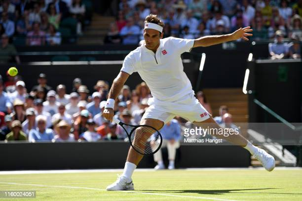 Roger Federer of Switzerland plays a backhand during his Men's Singles Second round match against Jay Clarke of Great Britain during Day four of The...