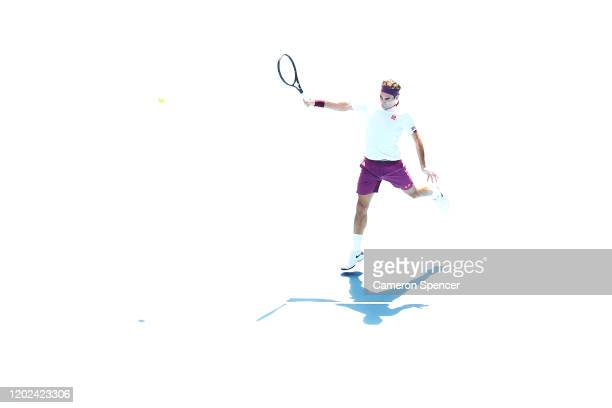 Roger Federer of Switzerland plays a backhand during his Men's Singles Quarterfinal match against Tennys Sandgren of the United States on day nine of...